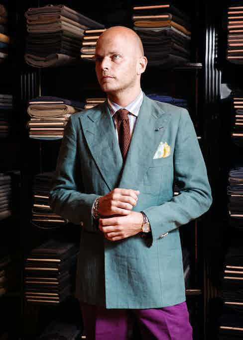 Luca's seafoam green linen double-breasted coat is trademark Rubinacci; colourful and nonchalant. He says 'having the buttons rolled low on a double-breasted jacket lends it an easier feel. I tend to button it to the higher button when I need to dress more formally'.