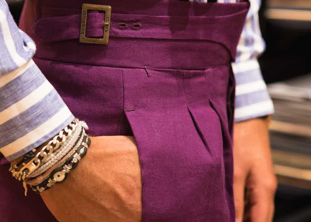 Luca's vivid purple trousers make a serious statement. Cut in a lightweight linen plainweave, the double-pleats and buckling waistband are Rubinacci signatures. Luca always has pleats on his tailored trousers - 'a flat front is best left for jeans and chinos.'
