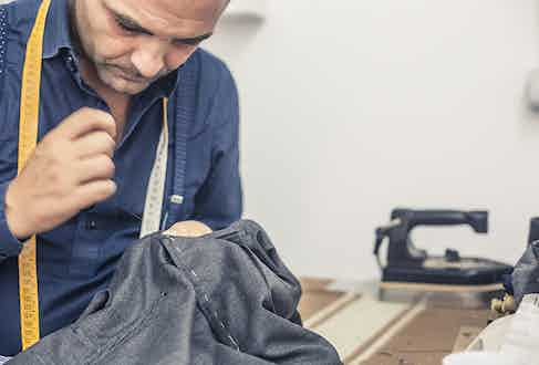 Antonio Ambrosi hand-stiches a pair of trousers