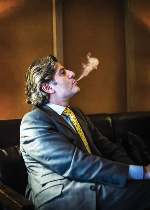 Eddie Sahakian mid-smoke.