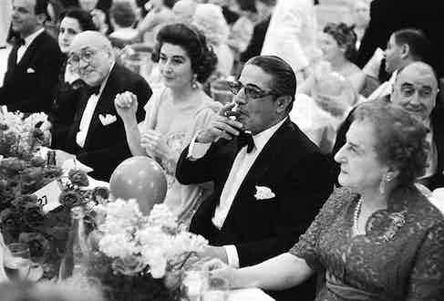 Greek billionaire Aristotle Onassis in Monte Carlo, enjoying a cigar at dinner.
