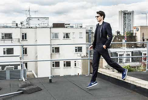 Midnight-blue silk shawl lapel spotted evening suit, Richard James; black and white spot V-neck T-shirt, Kilgour; clear grey acetate sunglasses, Oliver Goldsmith; Navy suede Air Force 1 07 sneakers, Nike.