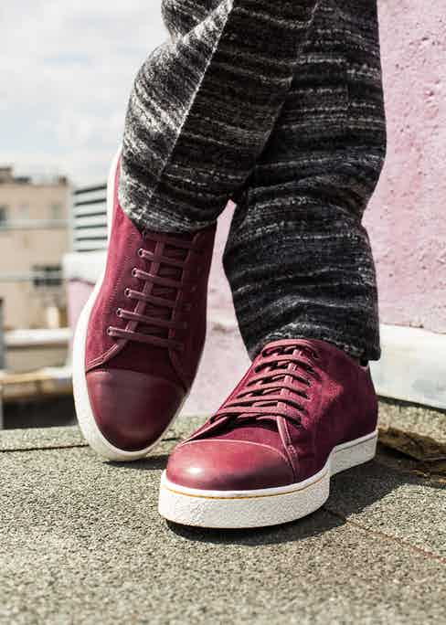 Levah burgundy suede and leather sneakers with white sole, John Lobb; charcoal melange horizontal stripe wool double-breasted suit.