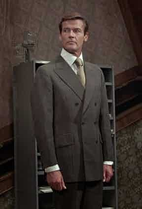 Roger Moore's double-breasted suit from Hayward displays a particularly full-cut chest.