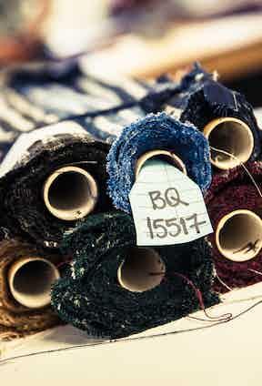 Rolls of silk jacquard awaiting cutting.