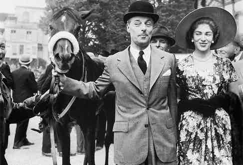 The Baron Guy de ROTHSCHILD and his young wife Marie Helene leading their mare CERISOLES to the paddock after it won the Prix de Diane in Chantilly on June 10, 1957.
