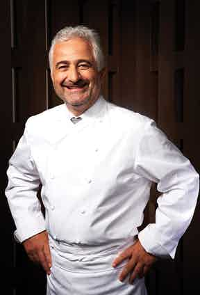 Exactly as the author remembers him, a smiling Guy Savoy at his three-Michelin- starred restaurant on Rue Troyon in Paris.