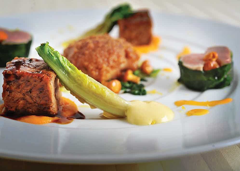 'L'Automne avec du Veau', a veal dish prepared in the style of autumn. Presented in three different forms, the veal is served as braised veal belly, slow-cooked veal breast and a filet mignon served with sweet breads and chanterelle mushrooms.