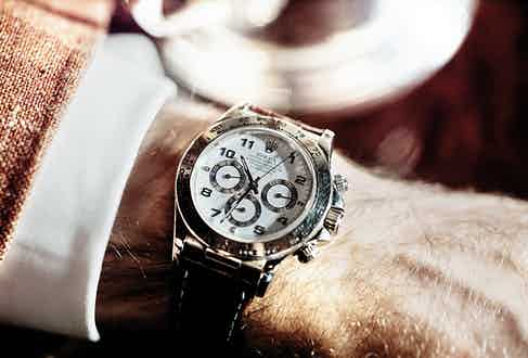 A Rolex Daytona on a leather crocodile strap has both aesthetic assiduousness and deep sentimentality, for the previous owner was his late father, whom Darius remembers wearing it.