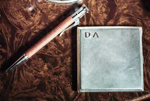 In the age of texting and instant messaging, keeping a pen as a constant companion is largely a lost tradition, but one Darius admirably continues. Here, the 1940s cigarette case was found in a bazaar and bears the initials of his childhood nickname.