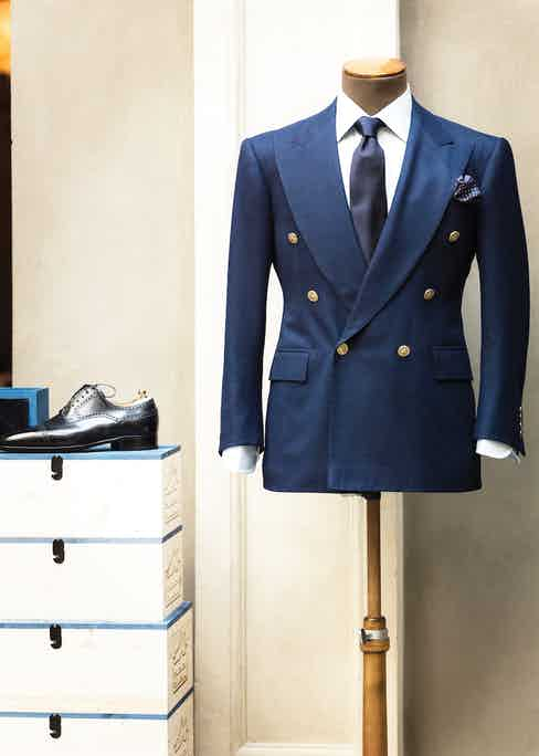 Cifonelli's French blue flannel blazer sits next to a timeless black brogue.