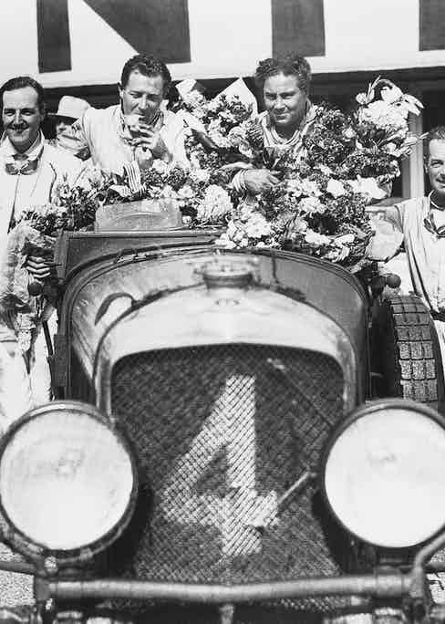 Glen Kidston (second from the left) and Woolf Barnato (third from the left) at their victorious 1930 Le Mans race.