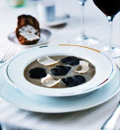 Perhaps one of Guy Savoy's most renowned dishes and one for which people will travel thousands of miles to savour: artichoke soup with black truffles and parmesan shavings, a dish so enjoyable you can only smile and then laugh in sheer delight. Your bouche will be more than amused.