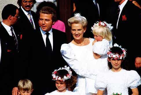 Newlyweds Thierry Roussel and Marianne Landhage with their bridesmaids, including Thierry's five-year-old daughter Athina (centre), and the couple's three-year-old daughter Sandrine (in her mother's arms).