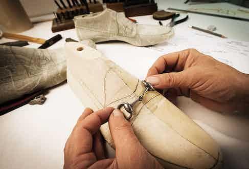 Designing a paper horsebit loafer pattern.