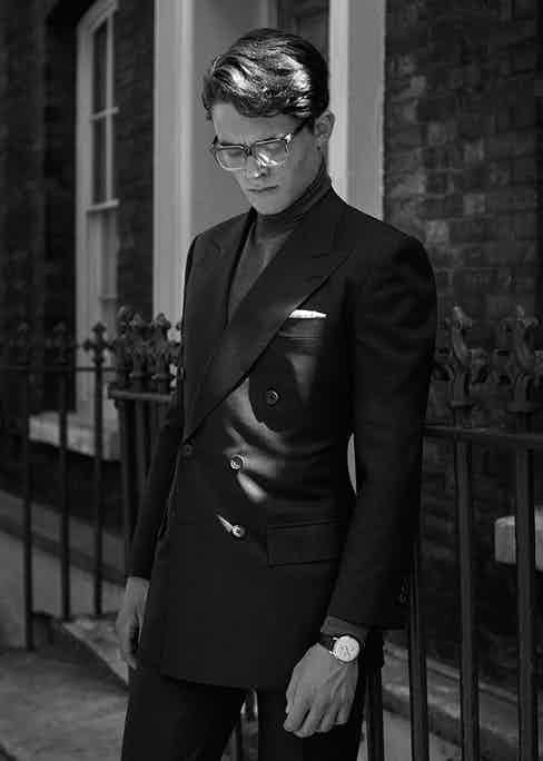 Charcoal grey wool two-piece double-breasted suit, Chittleborough & Morgan; slate-grey wool roll-neck jumper, John Smedley; white cotton pocket-handkerchief, Budd Shirtmakers; black and transparent acetate eye frames, Claire Goldsmith; WW1 Régulateur timepiece in rose gold with brown alligator-leather strap, Bell & Ross