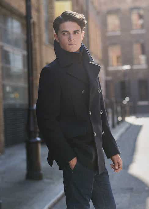 Navy Melton wool peacoat, Private White V.C.; blue cotton shirt and denim jeans, both Brunello Cucinelli; chocolate-brown cashmere roll-neck jumper, Anderson & Sheppard Haberdashery.