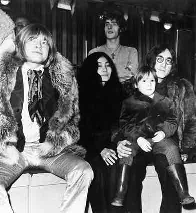 Brian Jones (1942 - 1969) with Yoko Ono, John Lennon (1940 - 1980) of the Beatles and the latter's son, Julian at a Wembley studio.