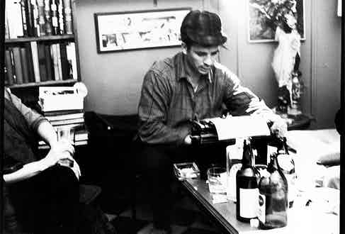 Jack Kerouac, with booze as his muse, types up a poem in 1959 in New York.