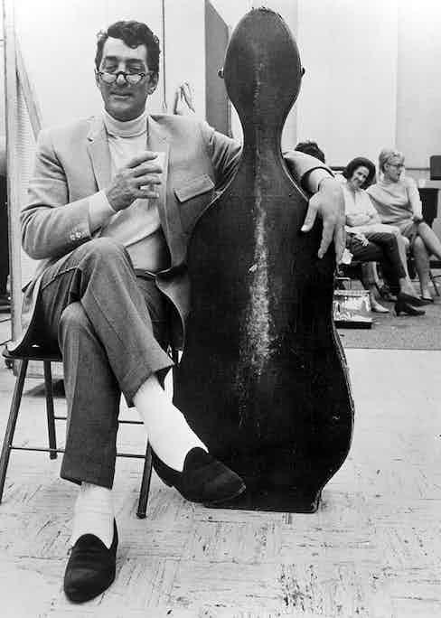 Dean Martin takes a break from recording in Los Angeles, circa 1964