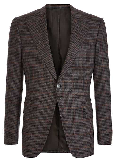 One of Huntsman's marvelous subtly checked sports coats, this one features the house's signature peaked lapel.