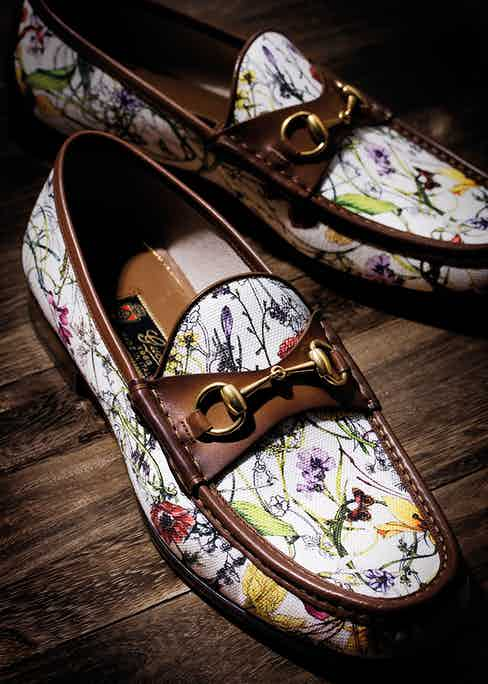 1953 Gucci horsebit loafers in a mini-flora infinity canvas and maple-brown leather trim.