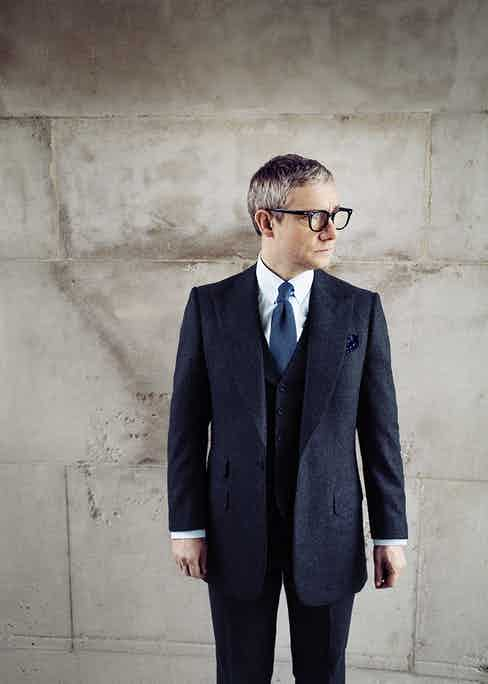 Grey Vitale Barberis Canonico flannel made-to-measure three-piece suit, Edward Sexton; sky-blue cotton shirt, Emmett London; steel-blue silk knitted tie, Budd Shirtmakers; navy wool and cashmere pocket handkerchief with white spots, Anderson & Sheppard Haberdashery. Vintage black acetate frames, USS, property of Martin Freeman.