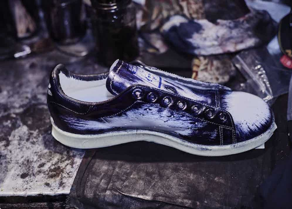 Lighter brush strokes cover the centre of the sneaker, building up the patina layer by layer.