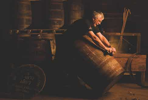 One of Glenfiddich's master coopers plies his trade.