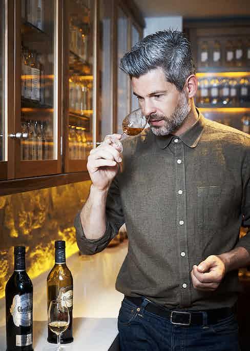 Mark Thomson, Glenfiddich Brand Ambassador, tastes a dram.