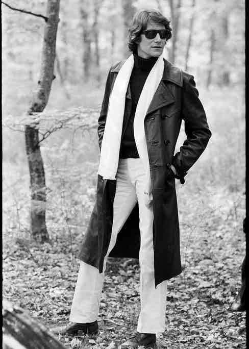 Algerian-born fashion designer Yves Saint Laurent poses outdoors in a leather trenchcoat and sunglasses in the CBS special 'The Paris Collections Fall Fashion Preview,' June 26, 1968. (Photo by CBS Photo Archive/Getty Images)