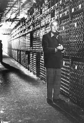 Baron Philippe de Rothschild in a wine cellar at Château Mouton Rothschild.