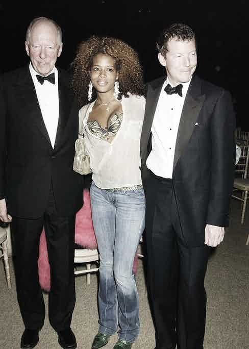 Nathaniel 'Nat' Rothschild and his father Baron Jacob with pop star Kelis at Louis Vuitton's 150th-anniversary party held at Waddesdon Manor, in 2004.