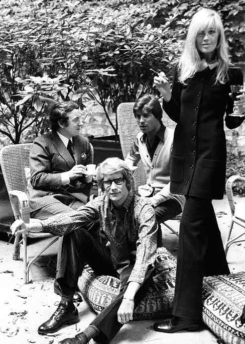 Yves Saint Laurent with partner Pierre Berge, Betty Catroux and her husband Francois Catroux in the graden of Yves Saint Laurent's Paris home. (Image by © Condé Nast Archive/Corbis)