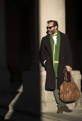Paul's Ulster coat comes from a local best-kept secret. 'It's from a Casentino specialist here in Florence. I was attracted to it for a few reasons; it's typically Florentine, timeless but also very chic – I can wear it with a suit but also with jeans or casualwear. I love the colour, but I really love it's emerald green lining.'