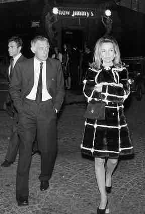 Lee departs a 1968 dinner at Maxim's, Paris, accompanied by Gianni Agnelli, with whom Jackie was rumoured to have had an affair during a 1962 vacation in Italy