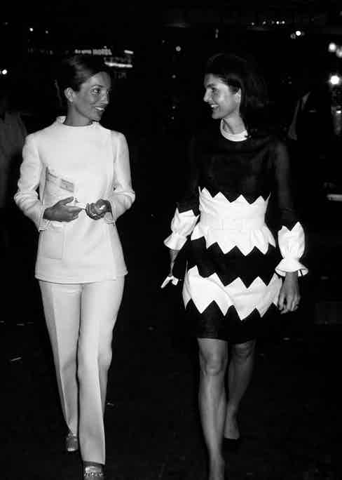 Lee Radziwill and Jackie Kennedy leaving Alvin Theatre (now Neil Simon Theatre) in Manhattan after a performance (1970)