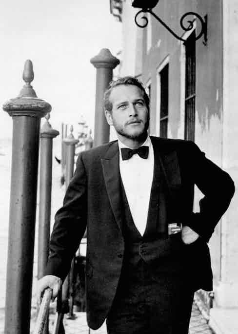 Photographed in Venice in 1963, Paul Newman's slim, restrained three piece dinner suit embodies early 1960s minimalism.