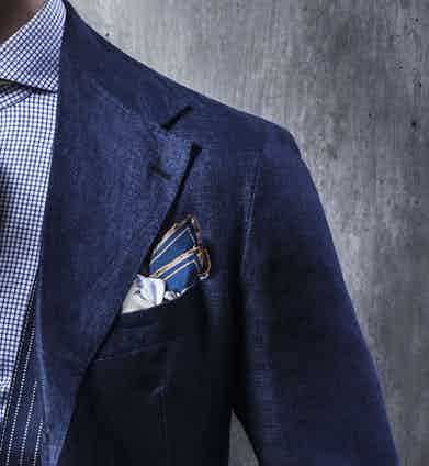 In rakish fashion, the blazer's lapels are heroically broad for a raffish summery aesthetic,