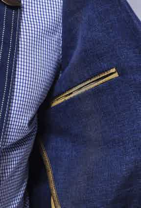 Note that the jacket's internal breast pockets are lined in The Rake's signature gold piping.