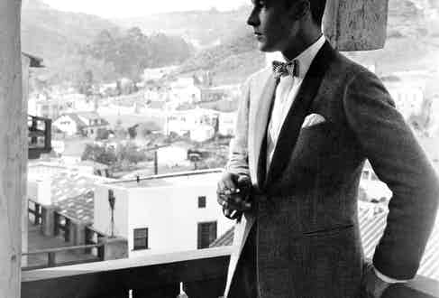 Jazz Age style icon Rudolph Valentino, in his informal evening coat in the early 1920s.