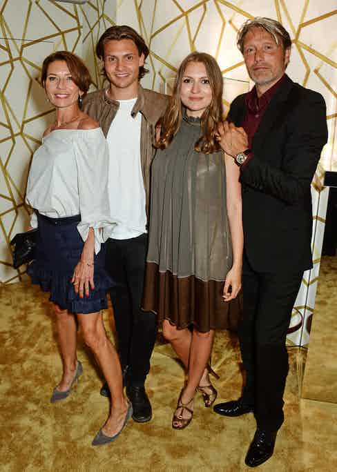 Mads Mikkelsen (R) poses with wife Hanne Jacobsen and children Carl Jacobsen Mikkelsen and Viola Jacobsen Mikkelsen attend the Chopard x Annabel's Cannes party on May 14, 2016 in Cannes, France.