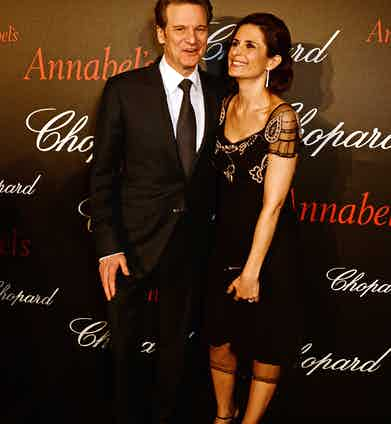 Colin Firth (L) and Livia Firth attend the Chopard x Annabel's Cannes party on May 14, 2016 in Cannes, France.