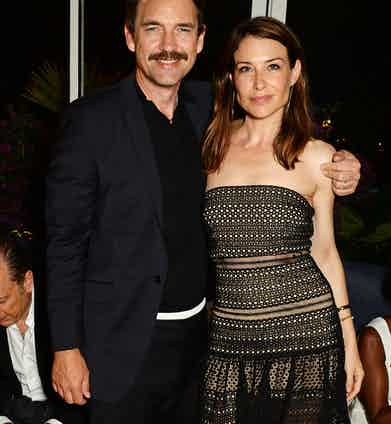 Dougray Scott (L) and Claire Forlani attend the Chopard x Annabel's Cannes party on May 14, 2016 in Cannes, France.