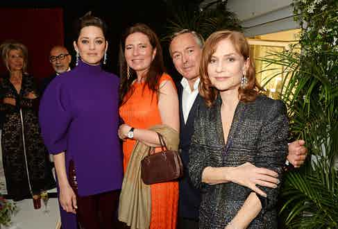 (L to R) Marion Cotillard, Christine Scheufele, Karl-Friedrich Scheufele, Co-President of Chopard, and Isabelle Huppert attend the Chopard x Annabel's Cannes party on May 14, 2016 in Cannes, France.