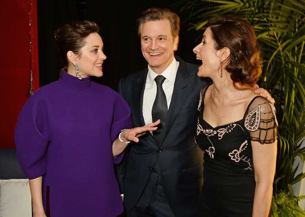 (L to R) Marion Cotillard, Colin Firth and Livia Firth attend the Chopard x Annabel's Cannes party on May 14, 2016 in Cannes, France.