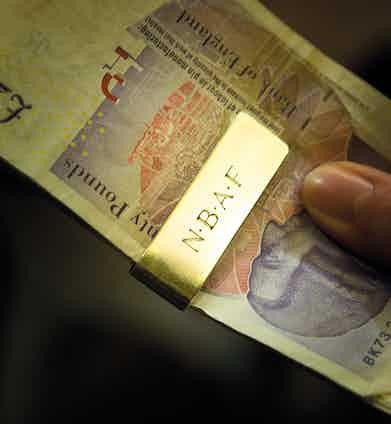 A money clip retains his lucre.