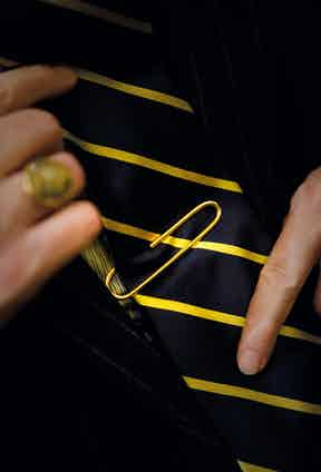The gold tie clip was inspired by one of Nick's friends, Bruno Capogreco. Nick brought a paper clip to his goldsmith for inspiration.