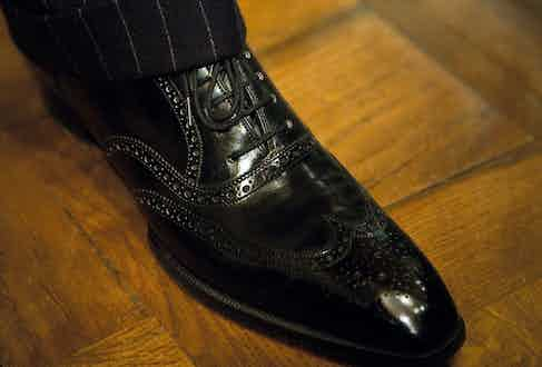 Nick bespeaks his lovely, slim benchmade shoes at London's Eric Cook. The pair he's wearing is 10 years old.