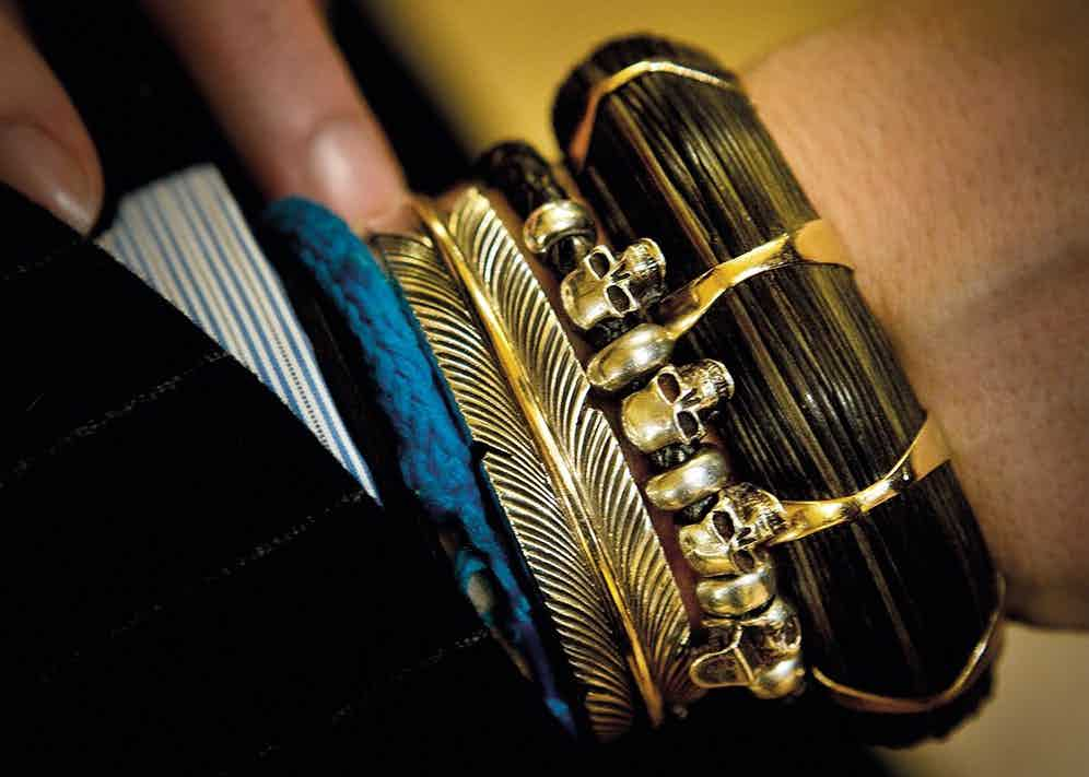 """Nick's right hand is adorned with bracelets: The blue bracelet is made by the younger of his two sons; the second is of American design but bought in Spain; the silver skulls were a gift from his wife and children — a witty reminder of """"Omnia Vanitas""""; the fourth one, made from elephant hair and pink gold, he rarely takes off. Foulkes explains, """"The only other one I've ever seen was owned by a woman who had it made in the 1930s."""""""